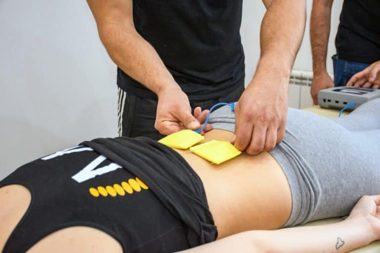 Ultrasonic physiotherapy, rehabilitation, kinesio, muscle pain, back pain, massage, massage table, people.